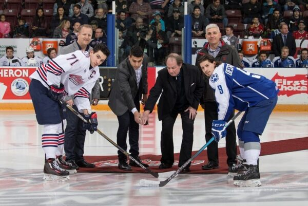 Owner of CARSTAR Oshawa Drake St., Mike Labanovich , owner of CARSTAR Pickering, Tom Akleh, owner of CARSTAR Oshawa King St., John Opasinis and Robert Howard, Campaign Director for the United Way of Durham Region dropped the puck to start the game. Photo Credit: Ian Goodall/Goodall Media Inc.