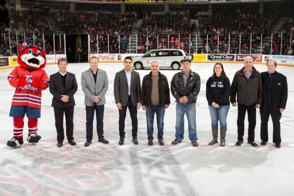 CARSTAR owners and representatives from the United Way Durham Region joined Deke at centre Ice for the Van presentation. Photo Credit: Ian Goodall/Goodall Media Inc.