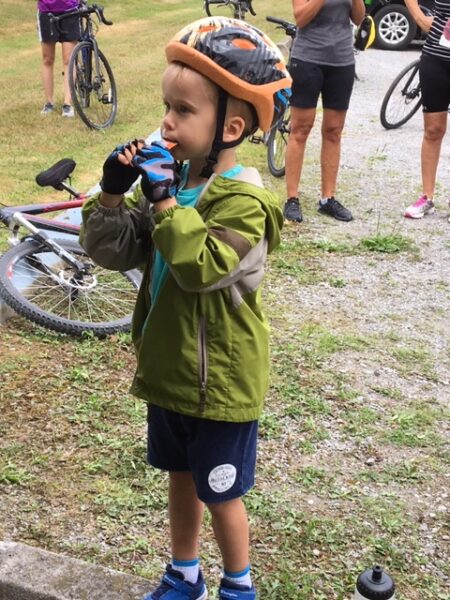 toddler with bike helmet