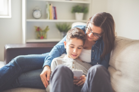 mother and son on couch reading